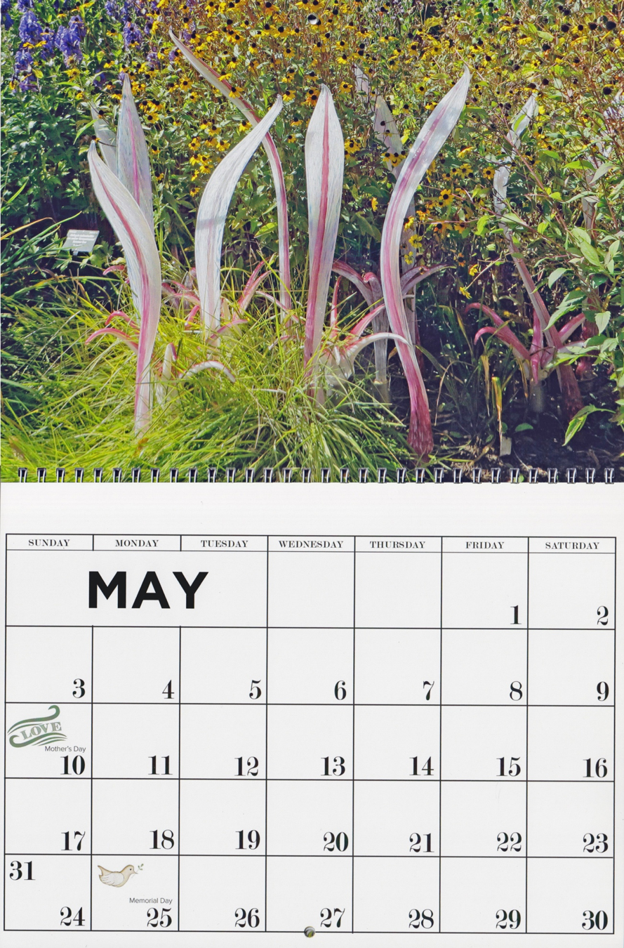 A calendar of a Chihuly exhibit is an example of a Place theme.