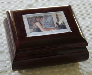 A music box personalized with a photograph.