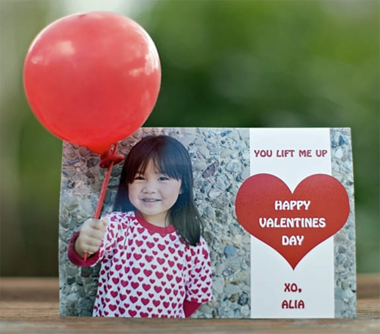 A lollipop card with the child holding a balloon instead of a lollipop.