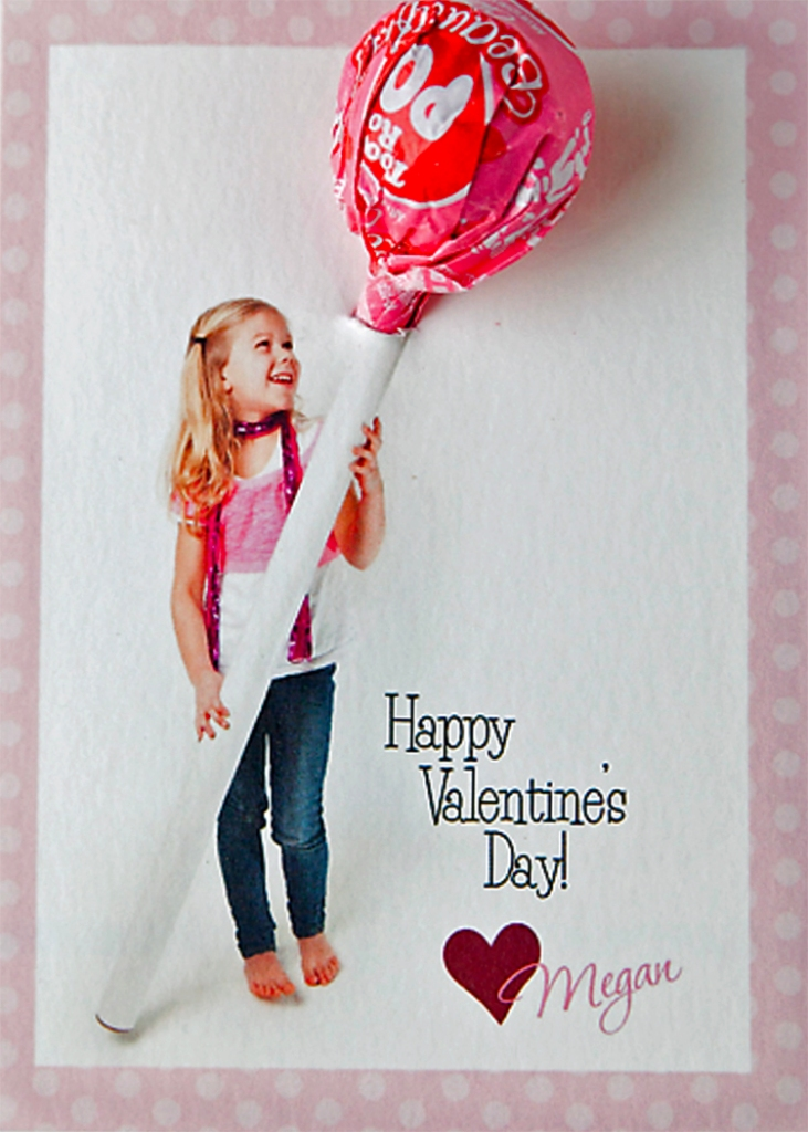 A lollipop card with the child holding a a tube with the lollipop coming out the end of the tube.
