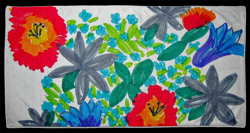 This photo is an illustration of the beach towel with the child's flower drawing.